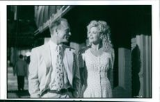 """Melanie Griffith and Ed Harris in the movie """"Milk Money"""". 1994."""
