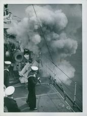Sailors in ship, smoke all around.