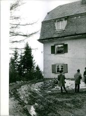Georges Bidault looking down from his house at people.