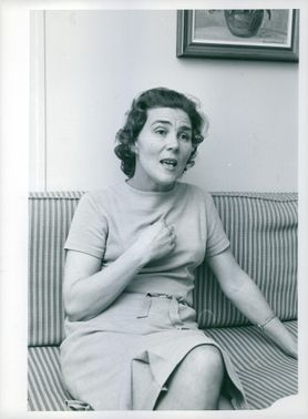 A lady sitting on a couch.