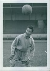 Man playing with football.