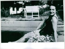 Astrid Blesvik by the pool.