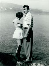Robert Charles Durman Mitchum standing with a woman.