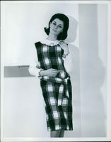 A lady in a checkered dress. March 4, 1963.