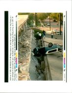 The 1994 Northridge earthquake USA:road to despair a car lies amid the ruins.