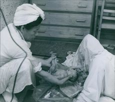 Woman holding a new born baby.