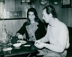 Vintage photo of Andre Marie, Prince of Bourbon Parma and his wife playing cards.