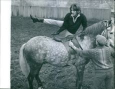 Irène Tunc, French actress and model, seen getting on the horse. 1961.