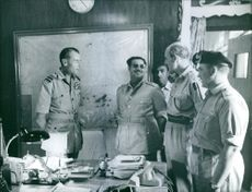 Kuwaiti soldiers standing in the office and talking. 1961