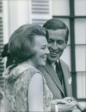 Princess Beatrix standing and talking to man.