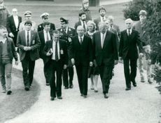 Chaim Herzog and German Chancellor Helmut Kohl surrounded by bodyguards