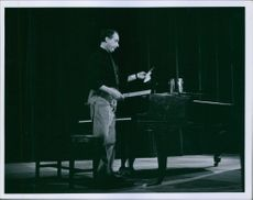 Victor Borge looking at something.