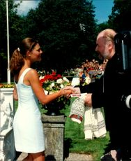 Crown Princess Victoria greets one of the guests at her 20th anniversary at Solliden.