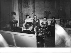 Mohammad Reza Pahlavi sitting between wife Farah and motherTadj ol-Molouk.