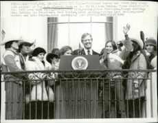 America's President Carter and his wife along with members of the Olympic squad at the White House