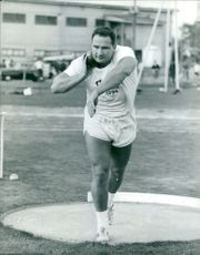 Shot putter preparing to throw, 1964.