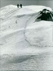 Two men leaving footprints on Monte Rosa.