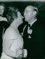 Queen Juliana and Prince Bernhard dancing.