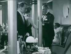 A photo of a man and a woman in a conversation in a film.