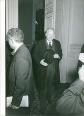 George Wildman Ball smiles as he enters the room.