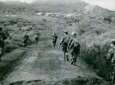 Soldiers walking in Vietnam.