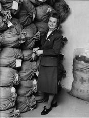 Mrs. Svea Kromnow with prepackaged Red Cross clothing sacks.