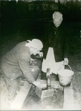 Men filling water from tap.