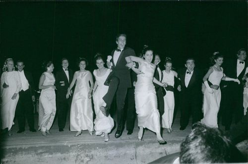 A vintage photo of young men and women having fun at their debutante ball. 1967