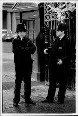 Policemen are guarded in London