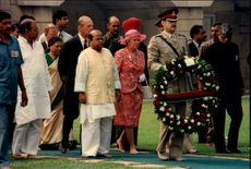 Queen Elizabeth and Prince Philip honored Mahatma Gandhi with a wreath on his grave.