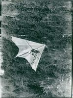 A man flying an air glider labeled Ikarus Akro.