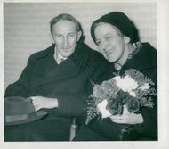 Jaroslav Heyrovsky and his wife Marie with flowers in their arms