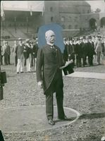 Vintage photo of Major General Baleck during an event.