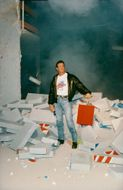Sylvester Stallone blows down a wall in Planet Hollywood Paris