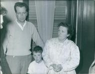 A photo of man and woman with little boy. January 3, 1962