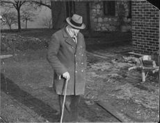 Winston Churchill smoking a cigarette while walking. 1940.