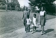 James Meredith walking in garden with this family.