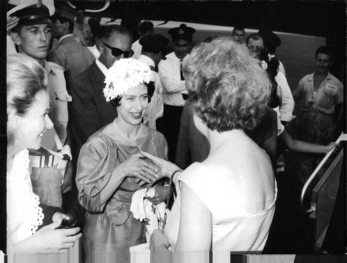 Princess Margaret shaking hand with a woman.