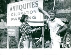 Man and woman standing by parking board.  Photo taken Aug.26,1963