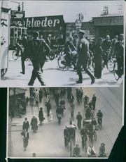 Soldiers running in the street of Denmark during WWII.