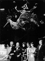 Danny Kaye on stage with people.