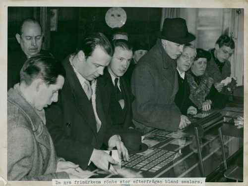 Stamp collectors in line at the free-print expedition to buy newly released stamps