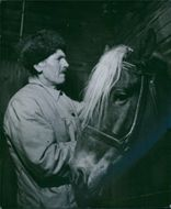 Man with horse, Sweden, 1945.