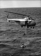 The Navy combat demonstration with helicopter rescue of a man overboard from the destroyer