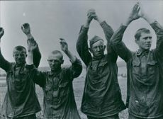 Soldiers raisinf their hands during the Russian Civil War.