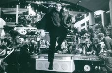 """A photo of Arnold Schwarzenegger as Howard Langston in the film """"Jingle All the Way"""". 1996."""