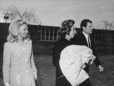 """Edward Moore """"Ted"""" Kennedy walking with women."""