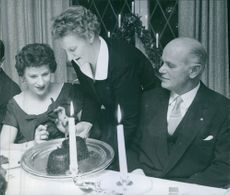 Man and woman siting and celebrating birthday together. 1958