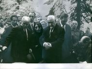 Nikolai Bulganin standing with other people during funeral ceremony.