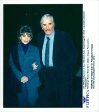 """Portrait image of Gregory Peck and his wife Veronique taken in connection with the premiere of the movie """"Body Dick""""."""